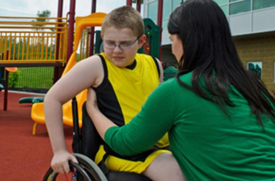 Carer with child in wheelchair FINAL