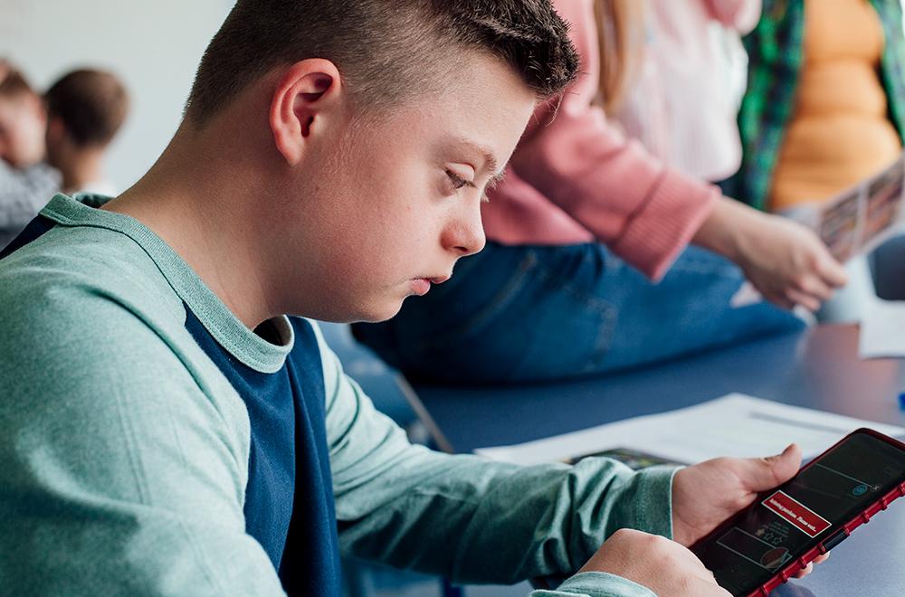 Boy reading cellphone